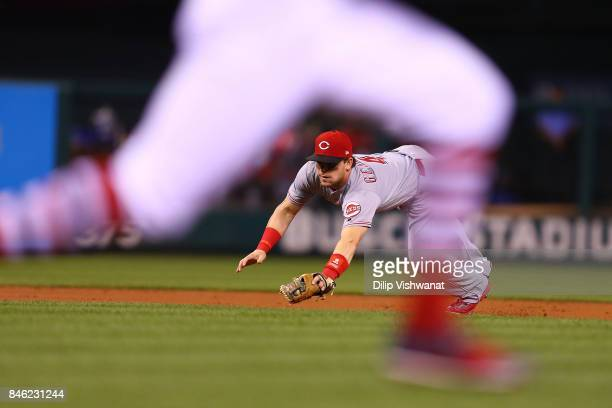 Scooter Gennett of the Cincinnati Reds dives for the ball against the St Louis Cardinals in the first inning at Busch Stadium on September 12 2017 in...