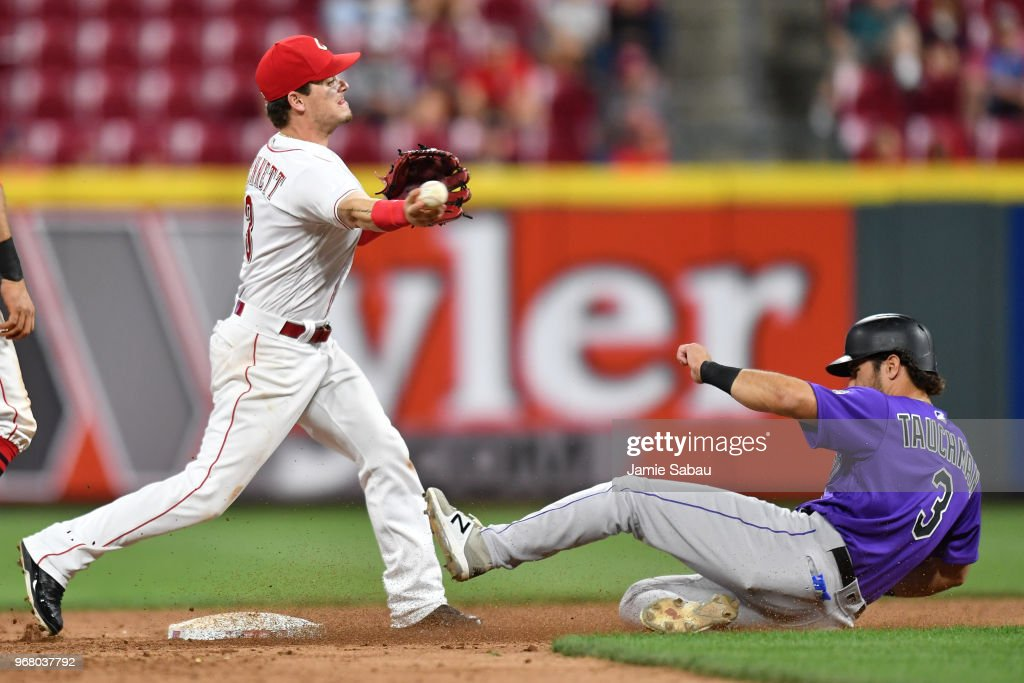 Scooter Gennett #3 of the Cincinnati Reds forces out Mike Tauchman #3 of the Colorado Rockies at second base to begin a double play in the eighth inning at Great American Ball Park on June 5, 2018 in Cincinnati, Ohio. Colorado defeated Cincinnati 9-6.