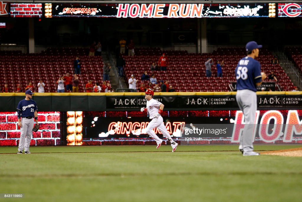 Scooter Gennett #4 of the Cincinnati Reds heads towards third base after hitting a three-run home run off of Wei-Chung Wang #58 of the Milwaukee Brewers during the seventh inning at Great American Ball Park on September 5, 2017 in Cincinnati, Ohio. Cincinnati defeated Milwuakee 9-3.