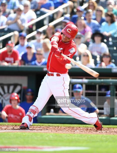 Scooter Gennett of the Cincinnati Reds hits a pitch during a spring training game against the Chicago Cubs at Goodyear Ballpark on March 04, 2019 in...