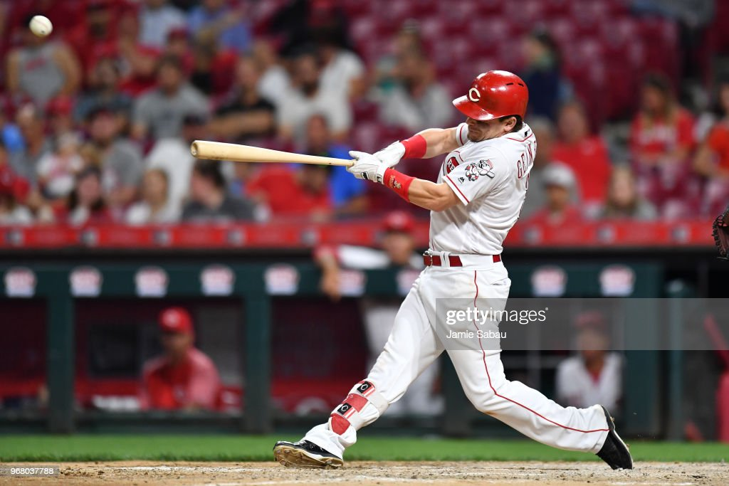 Scooter Gennett #3 of the Cincinnati Reds hits a single in the eighth inning against the Colorado Rockies at Great American Ball Park on June 5, 2018 in Cincinnati, Ohio. Colorado defeated Cincinnati 9-6.