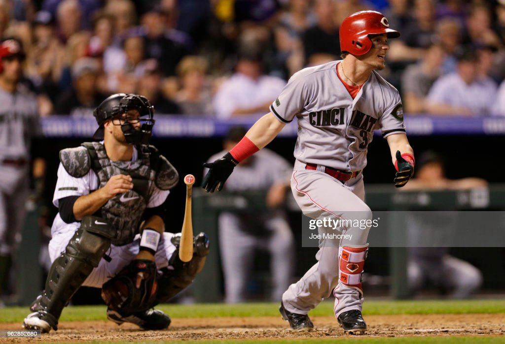 Scooter Gennett #3 of the Cincinnati Reds hits a single in the fifth inning against the Colorado Rockies at Coors Field on May 26, 2018 in Denver, Colorado.