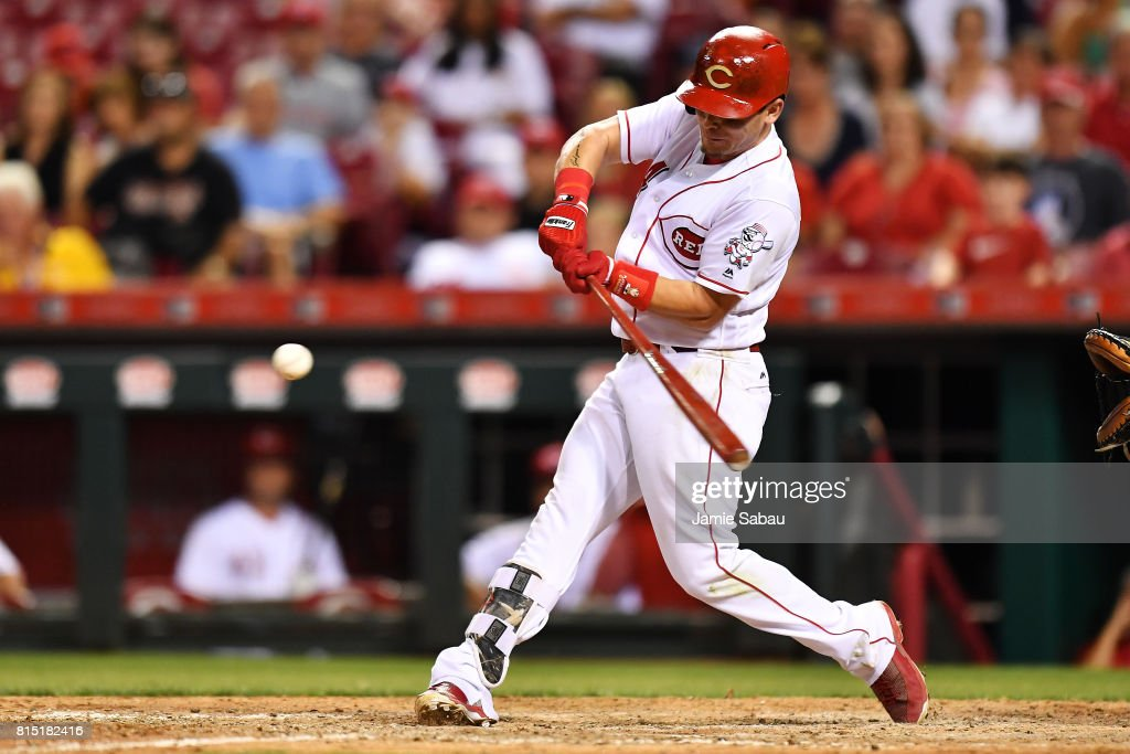 Scooter Gennett #4 of the Cincinnati Reds hits a three-run home run in the ninth inning against the Washington Nationals at Great American Ball Park on July 15, 2017 in Cincinnati, Ohio. Washington defeated Cincinnati 10-7.