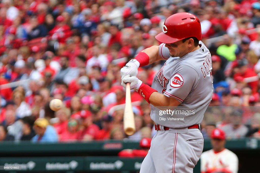 Scooter Gennett #3 of the Cincinnati Reds hits a two-run single against the St. Louis Cardinals in the seventh inning at Busch Stadium on April 21, 2018 in St. Louis, Missouri.