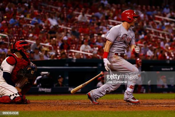 Scooter Gennett of the Cincinnati Reds hits an RBI single against the St Louis Cardinals in the seventh inning at Busch Stadium on July 14 2018 in St...
