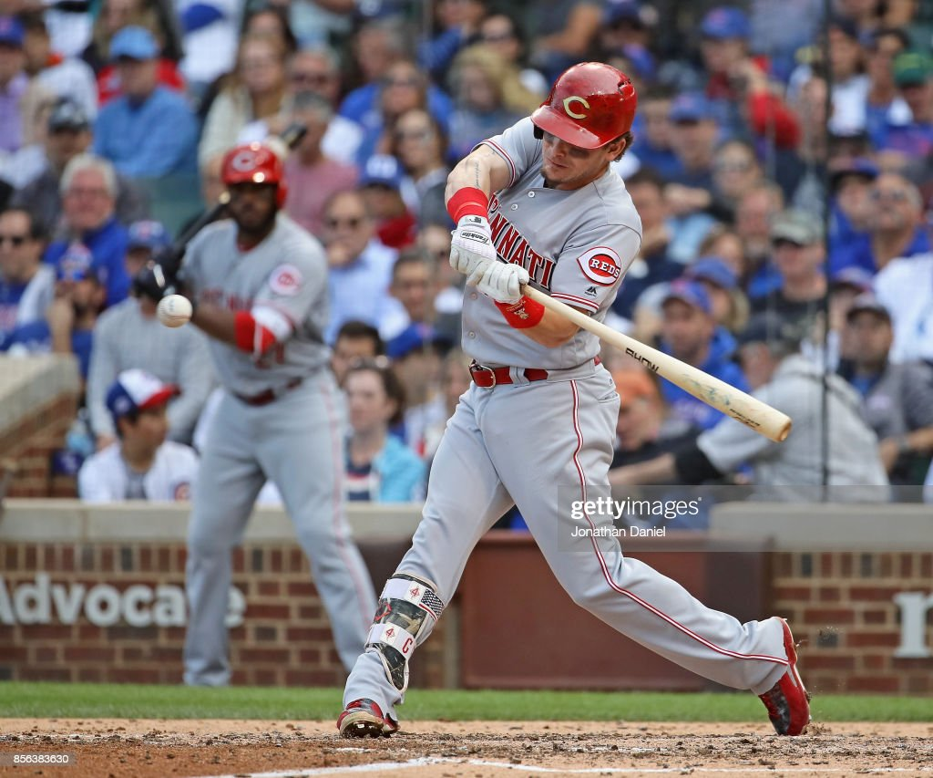 Scooter Gennett #4 of the Cincinnati Reds hits and RBI single in the 6th inning against the Chicago Cubs at Wrigley Field on October 1, 2017 in Chicago, Illinois.