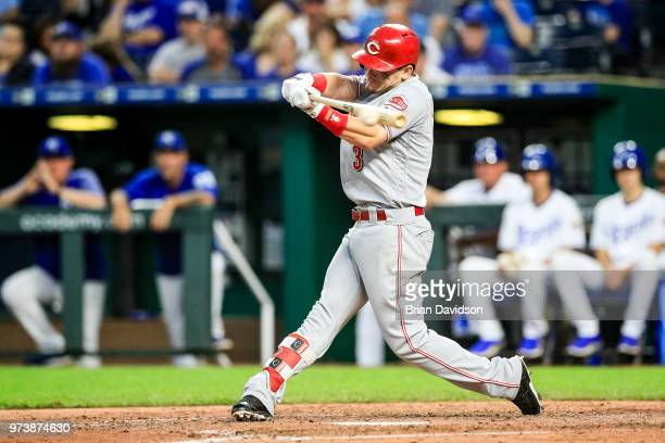 Scooter Gennett of the Cincinnati Reds hits the ball during the seventh inning and drives in Jose Peraza for a run against the Kansas City Royals at...