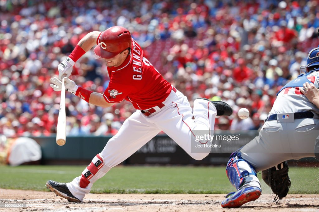 Scooter Gennett #3 of the Cincinnati Reds is hit by a pitch in the first inning against the Chicago Cubs at Great American Ball Park on May 20, 2018 in Cincinnati, Ohio.