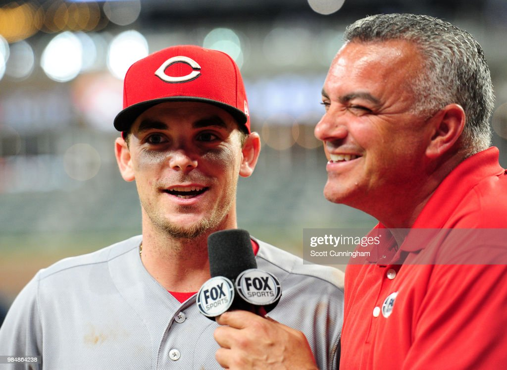 Scooter Gennett #3 of the Cincinnati Reds is interviewed by Jeff Precoro after the game against the Atlanta Braves at SunTrust Park on June 26, 2018 in Atlanta, Georgia.