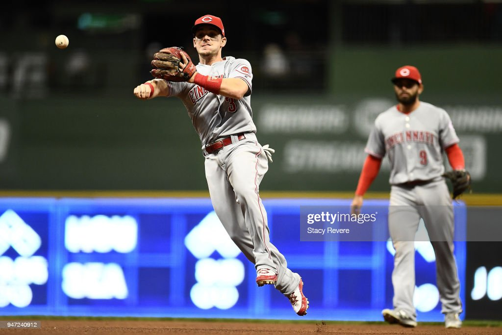Scooter Gennett #3 of the Cincinnati Reds makes a throw to first base during the fourth inning against the Milwaukee Brewers at Miller Park on April 16, 2018 in Milwaukee, Wisconsin.