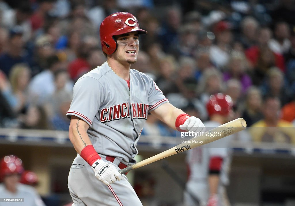 Scooter Gennett #3 of the Cincinnati Reds reacts after striking out swinging during the seventh inning of a baseball game against the San Diego Padres at PETCO Park on June 2, 2018 in San Diego, California.