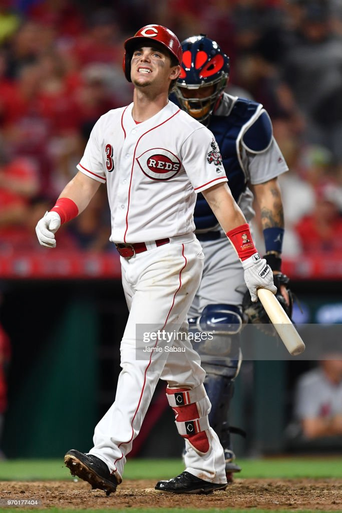 Scooter Gennett #3 of the Cincinnati Reds reacts as he walks back to the dugout after striking out in the seventh inning against the St. Louis Cardinals at Great American Ball Park on June 8, 2018 in Cincinnati, Ohio.