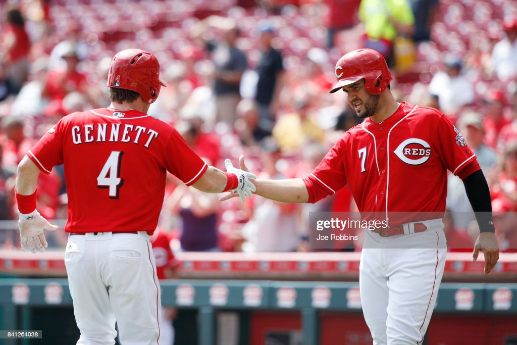 Scooter Gennett #4 of the Cincinnati Reds receives congratulations from teammate Eugenio Suarez #7 after a two-run home run in the second inning against the New York Mets at Great American Ball Park on August 31, 2017 in Cincinnati, Ohio.