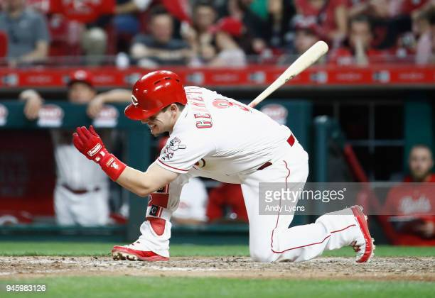 Scooter Gennett of the Cincinnati Reds swings and misses at a pitch in the eighth inning against the St Louis Cardinals at Great American Ball Park...