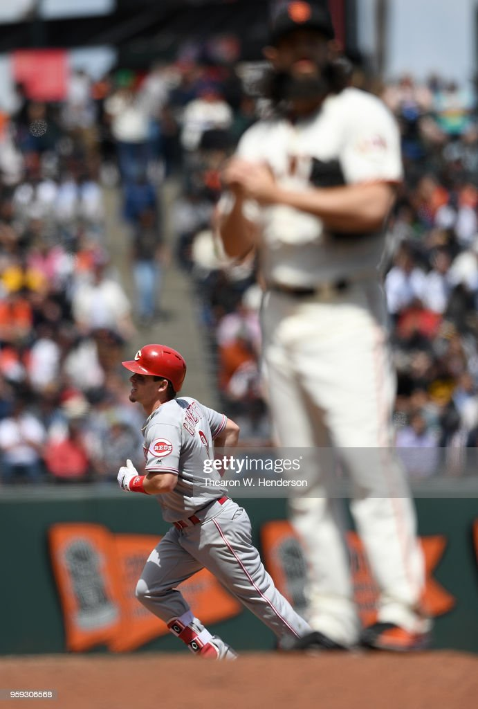 Scooter Gennett #3 of the Cincinnati Reds trots around the bases after hitting a solo home run off of Cory Gearrin #26 of the San Francisco Giants in the top of the seventh inning at AT&T Park on May 16, 2018 in San Francisco, California.