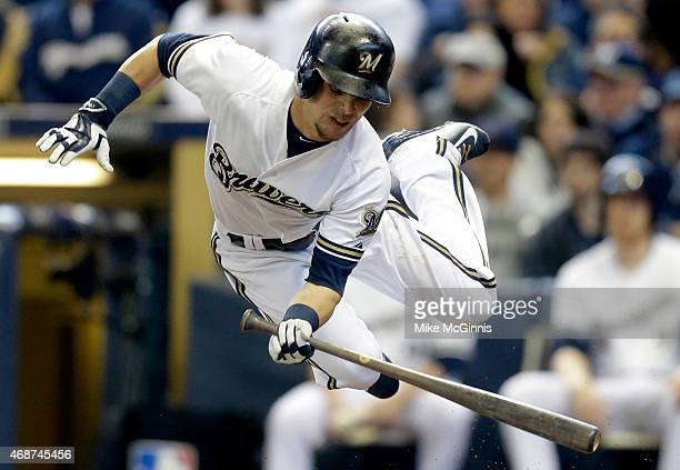 Scooter Gennett of the Milwaukee Brewers gets hit by a pitch in the second inning against the Colorado Rockies during Opening Day at Miller Park on...