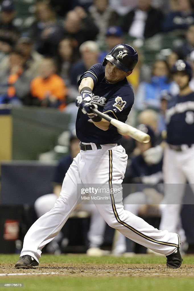 Scooter Gennett #2 of the Milwaukee Brewers hits a single in the bottom of the tenth inning against the San Diego Padres at Miller Park on April 22, 2014 in Milwaukee, Wisconsin.
