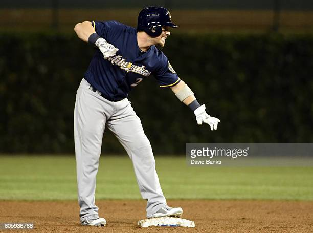 Scooter Gennett of the Milwaukee Brewers reacts after hitting a twoRBI double against the Chicago Cubs during the seventh inning on September 15 2016...