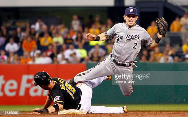 Scooter Gennett of the Milwaukee Brewers turns a double play in the third inning against the Pittsburgh Pirates during the game on August 29 2013 at...