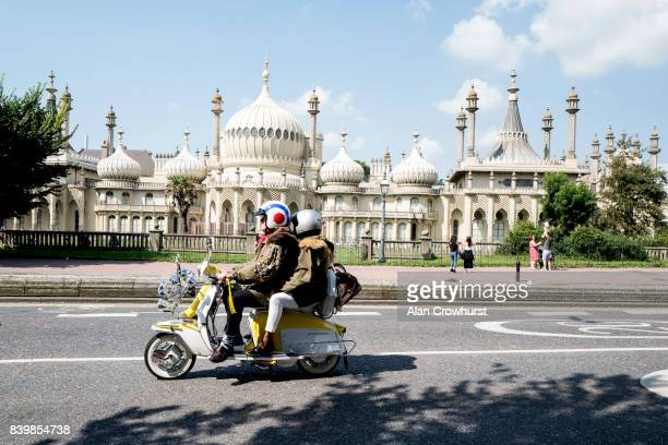 A scooter makes its way past The Royal Pavilion during The Mod Weekender on August 27 2017 in Brighton England Brighton became the meeting place for...
