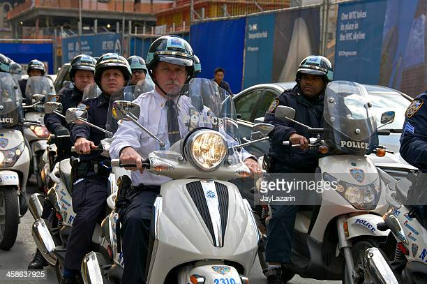 NYPD Scooter officers leave 'Occupy Wall Street' protest site.