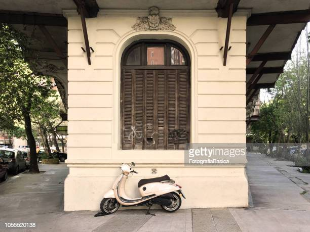 scooter parked in the street - palermo buenos aires stock photos and pictures