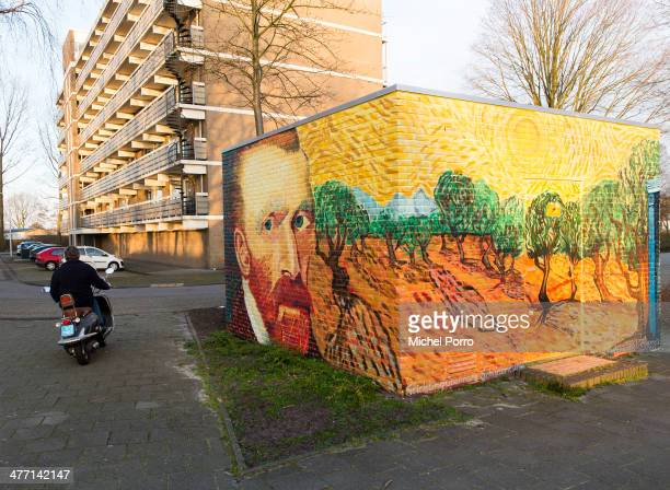 A scooter passes an electricity power substation which is decorated with replica's of original paintings by Vincent Van Gogh on March 7 2014 in...