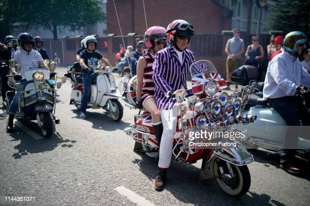 Scooter riders take part in the Manchester St George's Day parade on April 22 2019 in Manchester England Various parades have taken place across the...