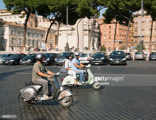 scooter transport in rome - vespa brand name stock pictures, royalty-free photos & images
