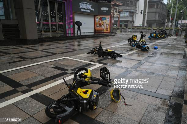 Scooters blown away by strong winds are seen in Ningbo, eastern China's Zhejiang province on July 25 ahead of Typhoon In-Fa's expected landfall in...