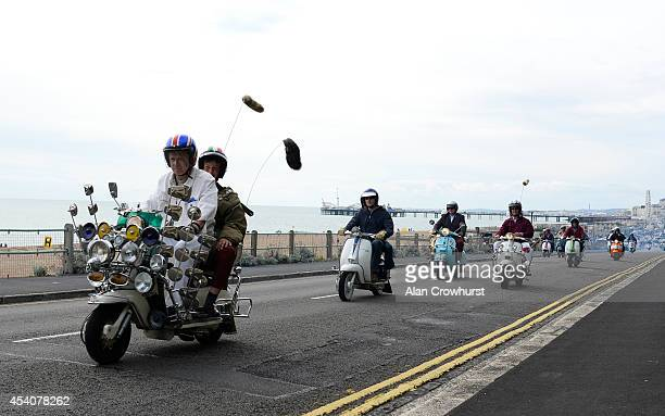 Scooters leave the seafront on a run out to Beachy Head during the Brighton Mod weekender on August 24 2014 in Brighton England This August Bank...