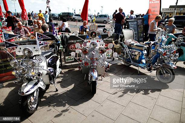 Scooters line up on the seafront during the Brighton Mod Weekender where mods and their scooters gather on the annual bank holiday weekend event on...