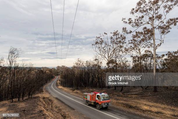 Scorched bushland on Thompsons Drive on March 25 2018 in Tathra Australia A bushfire which started on 18 March destroyed 65 houses 35 caravans and...