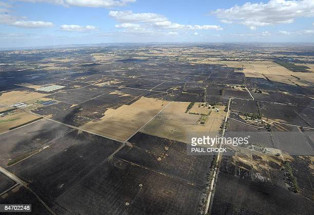 Scorched farmland shows the extent of the devastating wildfires which destroyed houses and farms and continues to burn in the Bunyip regions of...