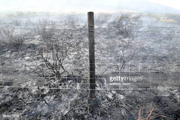 A scorched fencepost can be seen where a large wildfire has burnt the the moors above Stalybridge Greater Manchester on June 27 2018 in Stalybridge...