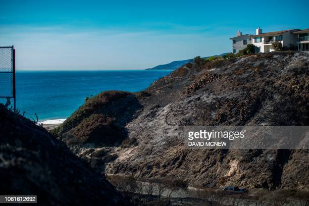 Scorched hillsides are seen where the Woolsey Fire reached the ocean on November 14 2018 near Malibu California