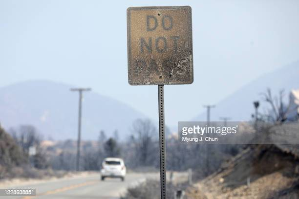 A scorched road sign on Devils Punchbowl Road in Pearblossom after the Bobcat Fire burned through the area Photographed on Sunday Sept 20 2020