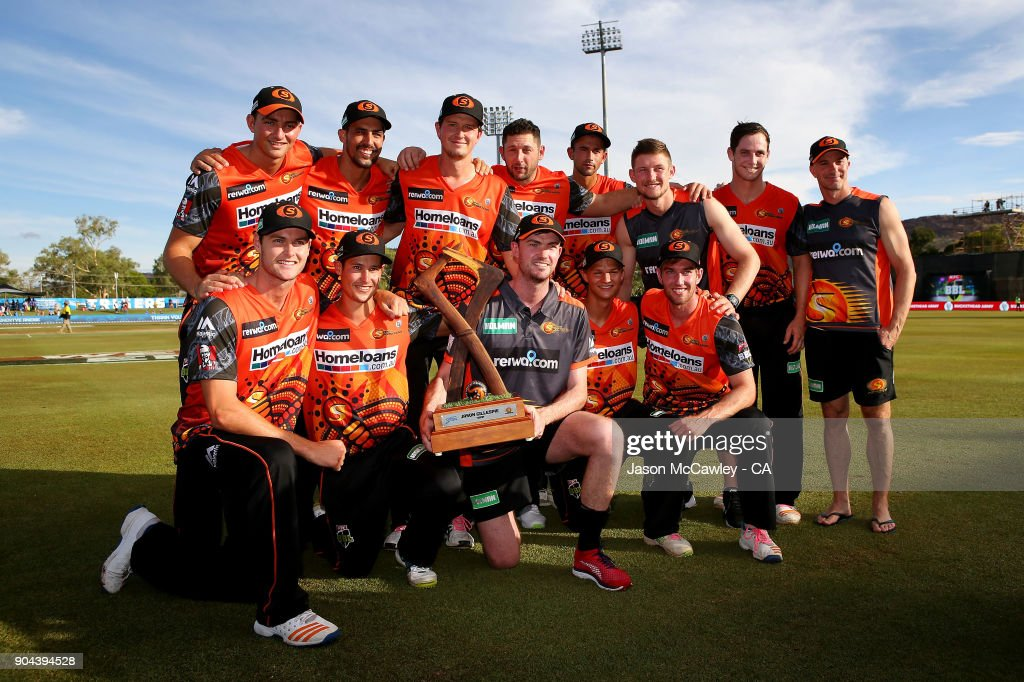 Scorcher players pose with the Jason Gillespie Trophy after winning the Big Bash League match between the Adelaide Strikers and the Perth Scorchers at Traeger Park on January 13, 2018 in Alice Springs, Australia.