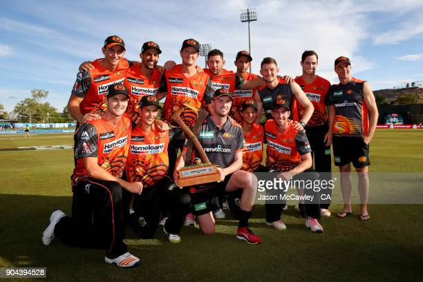 Scorcher players pose with the Jason Gillespie Trophy after winning the Big Bash League match between the Adelaide Strikers and the Perth Scorchers...