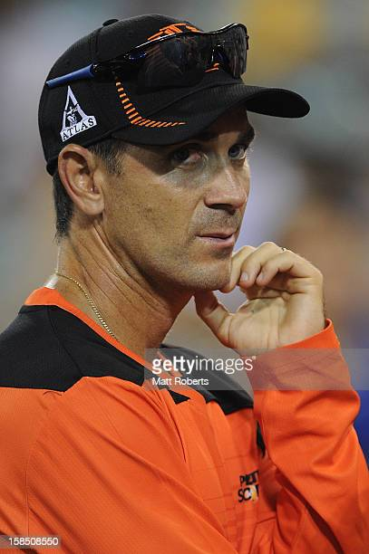 Scorchers coach Justin Langer looks on during the Big Bash League match between the Brisbane Heat and the Perth Scorchers at The Gabba on December 18...