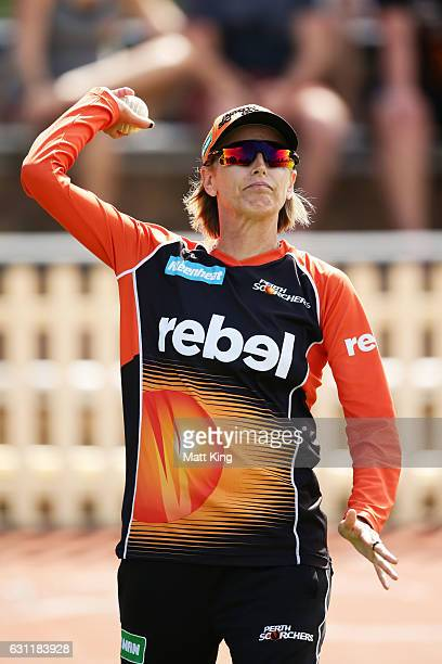Scorchers coach Lisa Keightley throws balls during batting warm up during the Women's Big Bash League match between the Perth Scorchers and the...
