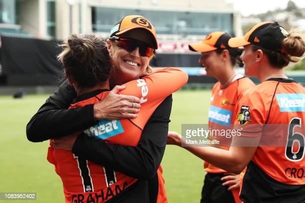 Scorchers head coach Lisa Keightley embraces Heather Graham of the Scorchers after victory in the Women's Big Bash League match between the Hobart...