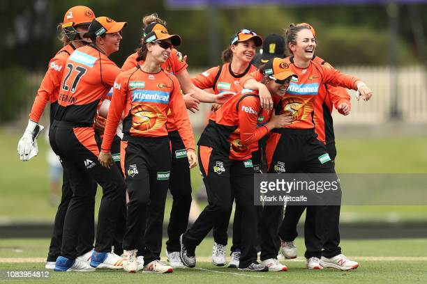Scorchers players celebrate after a super over victory during the Women's Big Bash League match between the Hobart Hurricanes and the Perth Scorchers...