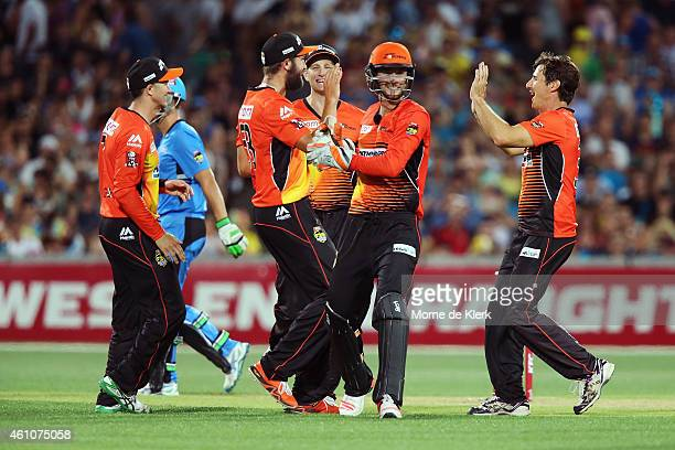 Scorchers players celebrate after Sam Whiteman of the Perth Scorchers stumped Alex Ross of the Adelaide Strikers during the Big Bash League match...