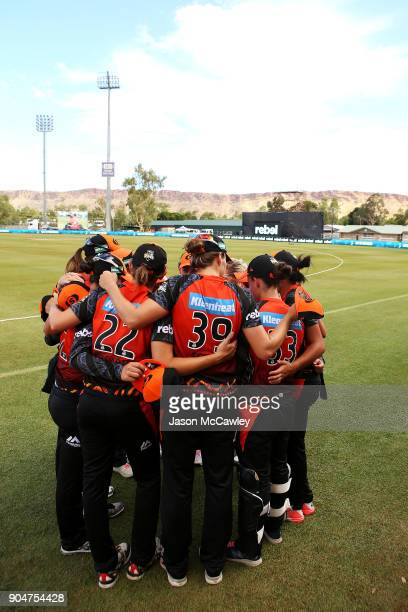Scorchers players form a huddle during the Women's Big Bash League match between the Perth Scorchers and the Adelaide Strikers at Traeger Park on...