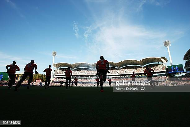 Scorchers players take to the field before the start of play in the Big Bash League match between the Adelaide Strikers and Perth Scorchers at...