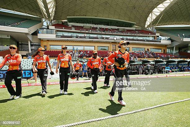 Scorchers players take to the field led by their captain Nicole Bolton before the Women's Big Bash League match between the Adelaide Strikers and the...