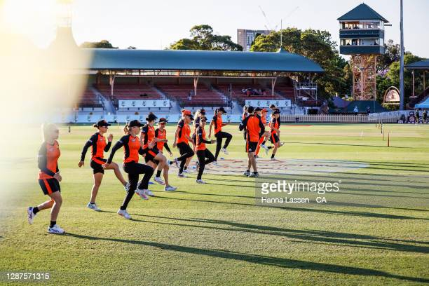 Scorchers players warm up prior to the Women's Big Bash League WBBL Semi Final match between the Melbourne Stars and the Perth Scorchers at North...