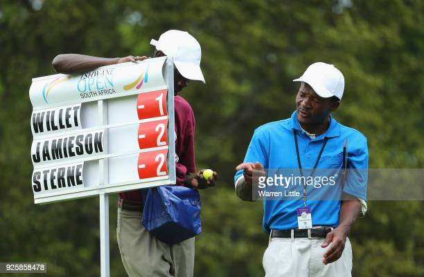 A score board carrier admires a ball given to him by a player during the first round of the Tshwane Open at Pretoria Country Club on March 1 2018 in...