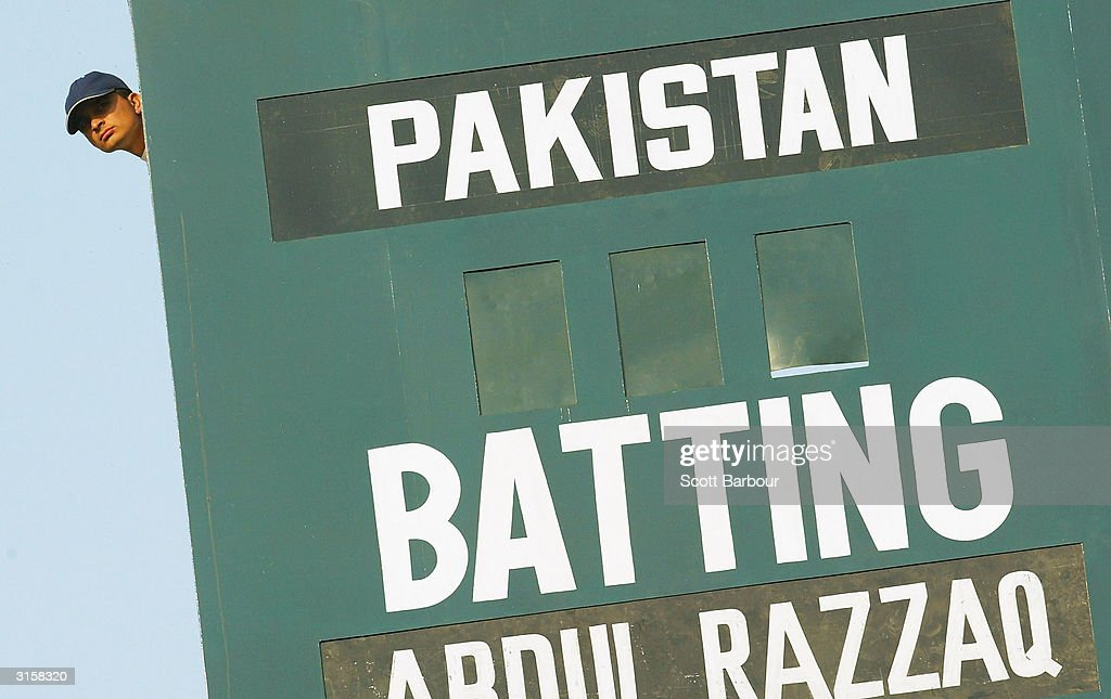 A score board worker watches the match during day 3 of the 1st Test Match between Pakistan and India at Multan Stadium on March 30, 2004 in Multan, Pakistan.